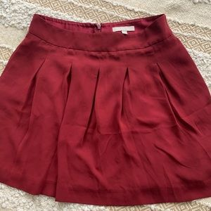 Pleated A-line burgundy skirt